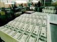 Печатный станок США увеличил объем наличных долларов на 39%